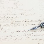 old  feather pen on  handwritten letter background